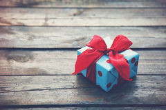 Gift box on wooden table Royalty Free Stock Image