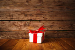Gift box with wooden. Table background Royalty Free Stock Images