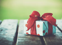 Gift box on wooden table Stock Photography