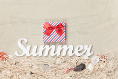 Gift box and word Summer Stock Images