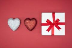 Gift box wrap silk ribbon with love heart shape Royalty Free Stock Photography