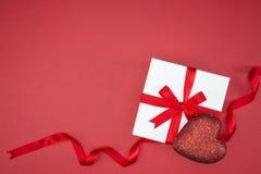 Gift box wrap silk ribbon with love heart shape Stock Photography