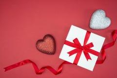 Gift box wrap silk ribbon with love heart shape Royalty Free Stock Image
