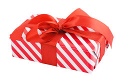 Gift box wrapped. In striped paper and a bow. Object with Clipping Paths Stock Image