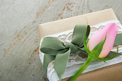 Gift box wrapped in brown paper with rose Royalty Free Stock Images