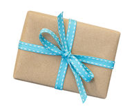 Gift box wrapped in brown recycled paper with blue ribbon top vi. Ew isolated on white background, clipping path included stock photo