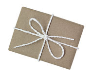 Gift box wrapped in brown recycled paper and tied cotton rope to Stock Image