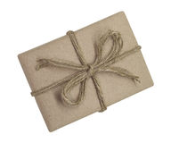 Gift box wrapped in brown recycled paper and tied sack rope top Stock Photography
