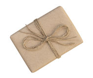 Gift box wrapped in brown recycled paper and tied sack rope top Royalty Free Stock Photos