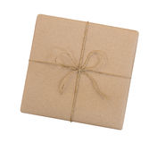 Gift box wrapped in brown recycled paper and tied sack rope top stock images