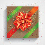 Gift box wrapped on brown wrinkled paper with red bow Royalty Free Stock Photo