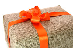 Gift box wrapped by burlap Royalty Free Stock Image