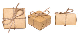 Gift box wrapped in kraft paper isolated on white background. Set of boxes Royalty Free Stock Photo