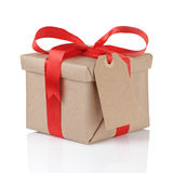 Gift box wrapped with kraft paper and red bow Stock Photo