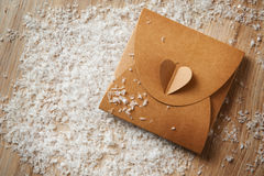 Gift box wrapped in kraft paper with ribbon bow Stock Images
