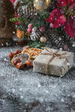 Gift box wrapped linen cloth and decorated with  cord, jute, christmas decoration on brown vintage wooden boards background. Drawn Royalty Free Stock Image
