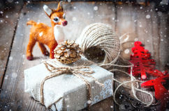 Gift box wrapped linen cloth and decorated with cord, jute, christmas decoration. Drawn Snowfall Stock Images