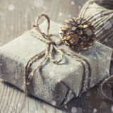 Gift box wrapped linen cloth and decorated with cord, jute, christmas decoration. Drawn Snowfall Stock Photos