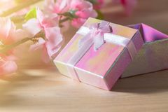 Gift box wrapped and plum blossom Christmas and Newyear presents with bows and ribbons, Christmas frame boxing day background. Gift box wrapped and plum blossom Royalty Free Stock Images