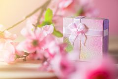Gift box wrapped and plum blossom Christmas and Newyear presents with bows and ribbons, Christmas frame boxing day background. Gift box wrapped and plum blossom Stock Photo
