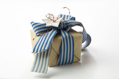 Gift box wrapped in recycled paper, blue ribbon bow Stock Photo