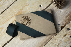Gift box, wrapped in recycled paper, green bow Stock Photos
