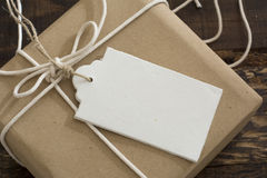 Gift box wrapped in recycled paper with label Royalty Free Stock Photos