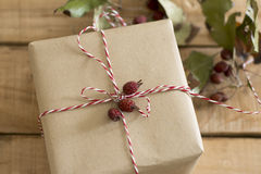 Gift box wrapped in recycled paper Stock Images