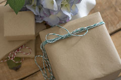 Gift box wrapped in recycled paper Royalty Free Stock Images
