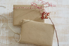 Gift box wrapped in recycled paper with ribbon bow Royalty Free Stock Images