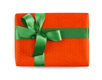 Gift box wrapped in red paper and green ribbon Royalty Free Stock Image