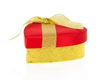 Gift box wrapped to red and gold in heart form Royalty Free Stock Images