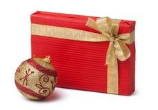 Gift box and xmas ball Royalty Free Stock Photo