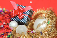 Gift box and xmas decoration. On the red Stock Image