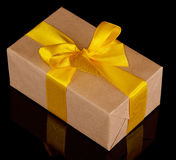 Gift box with yellow bow Royalty Free Stock Photo