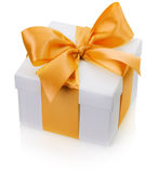 Gift box with yellow bow isolated on the white background Stock Images