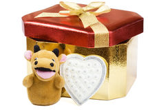 Gift box and yellow bull Royalty Free Stock Photography