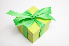 Gift box in yellow Stock Images