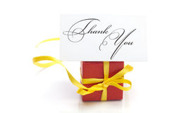 Gift box with a yellow ribbon Stock Images