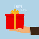 A gift box for you - a hand holding. Royalty Free Stock Images