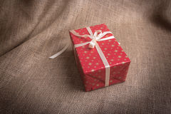 Gift boxe on the background of a sacking. Stock Photos