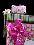 Gift boxes. Holiday gift boxes background with colorful decorative bows and ribbons Royalty Free Stock Photo