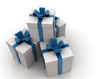 Gift boxes. Wrapped White gift boxes with blue ribbons and bow - seen from above Royalty Free Stock Photos
