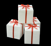 Gift boxes. Stacked together on black background Royalty Free Stock Photos