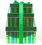 Gift Boxes. Green and Silver gift boxes stacked and wrapped with ribbon stock image