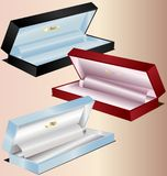 Gift boxes. On a pink background three miniature gift boxes - red, blue and black Stock Images