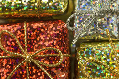 Gift boxes. Close up of metallic shining gift boxes stock image