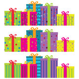 Gift Boxes. Colorful gift boxes with ribbons & bows.  Horizontal arrangement with 3 decoration styles - plain striped (bottom), plain decorated (middle) and a Royalty Free Stock Images