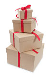 Gift boxes. Stack of gift boxes of different sizes each tied with red ribbon Royalty Free Stock Photography