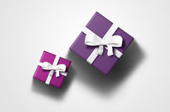 Gift boxes. Two gift boxes with ribbons: purple and pink Stock Photo